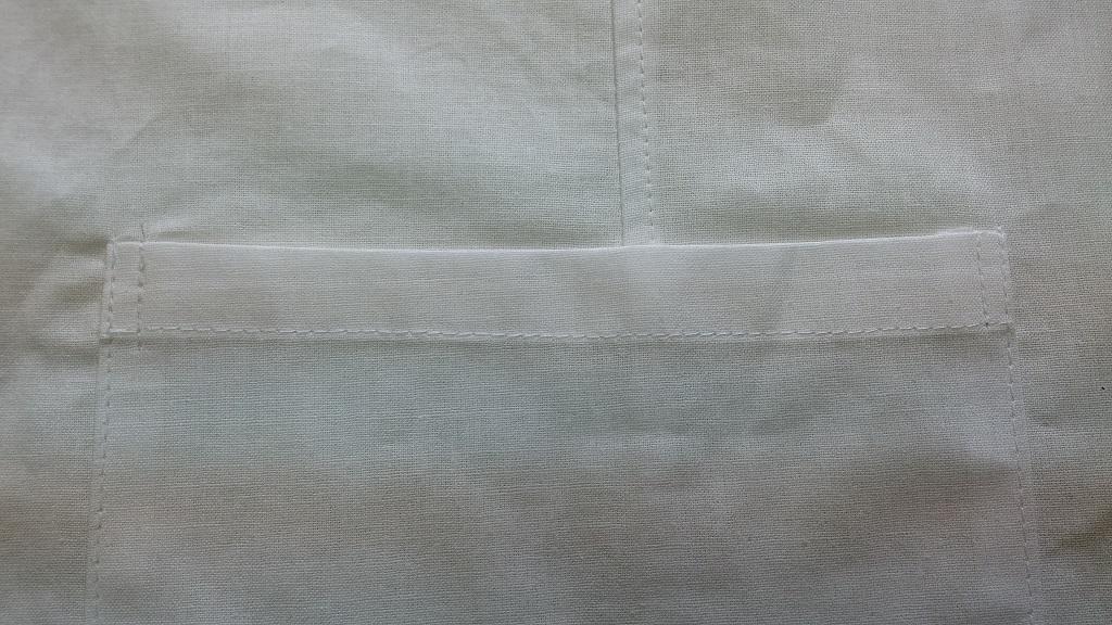Фартук поварской из бязи хлопчатобумажной отбеленной. Обработка кармана.